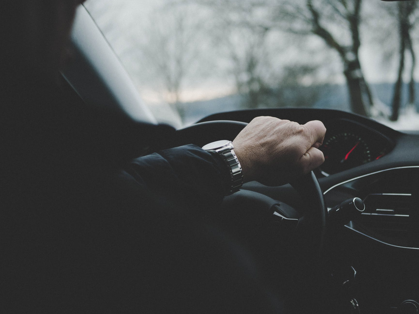 photo of person driving